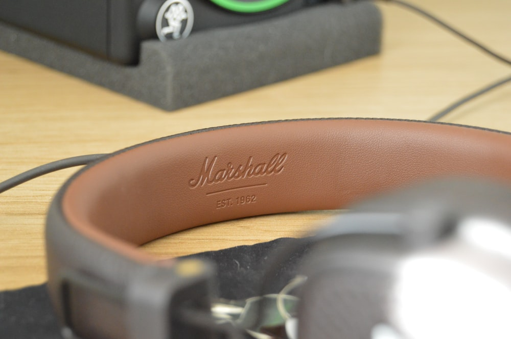 brown leather strap on brown wooden table