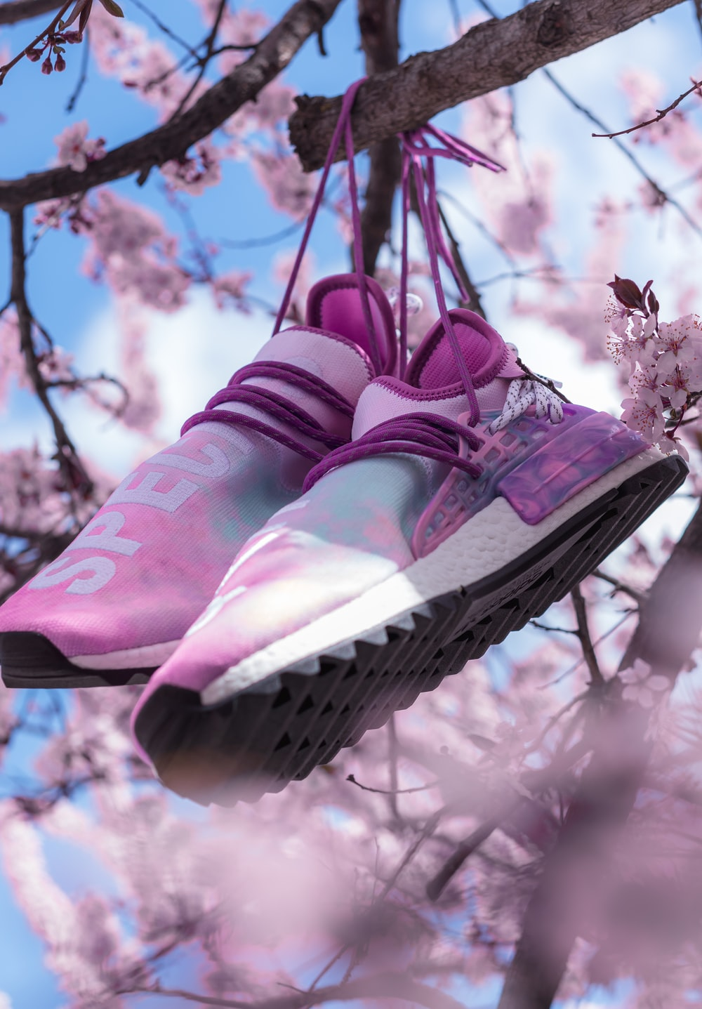 pink and white nike sneakers