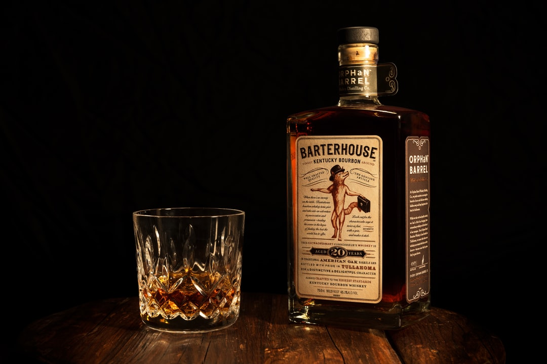 Personal work; product shot of a bottle of Orphan Barrel Barterhouse bourbon and a Waterford Crystal tumbler.