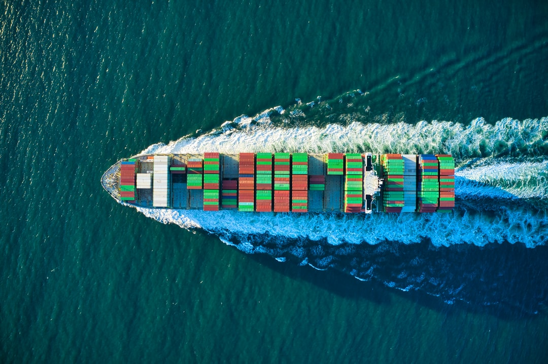 Colorful cargo ship headed out to see aerial