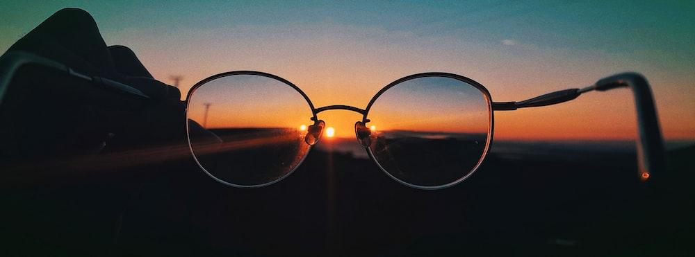 black framed sunglasses on black background