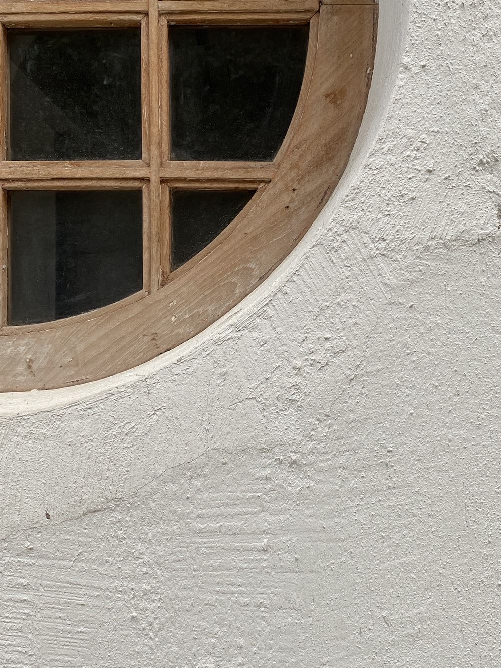 brown wooden window frame on white concrete wall