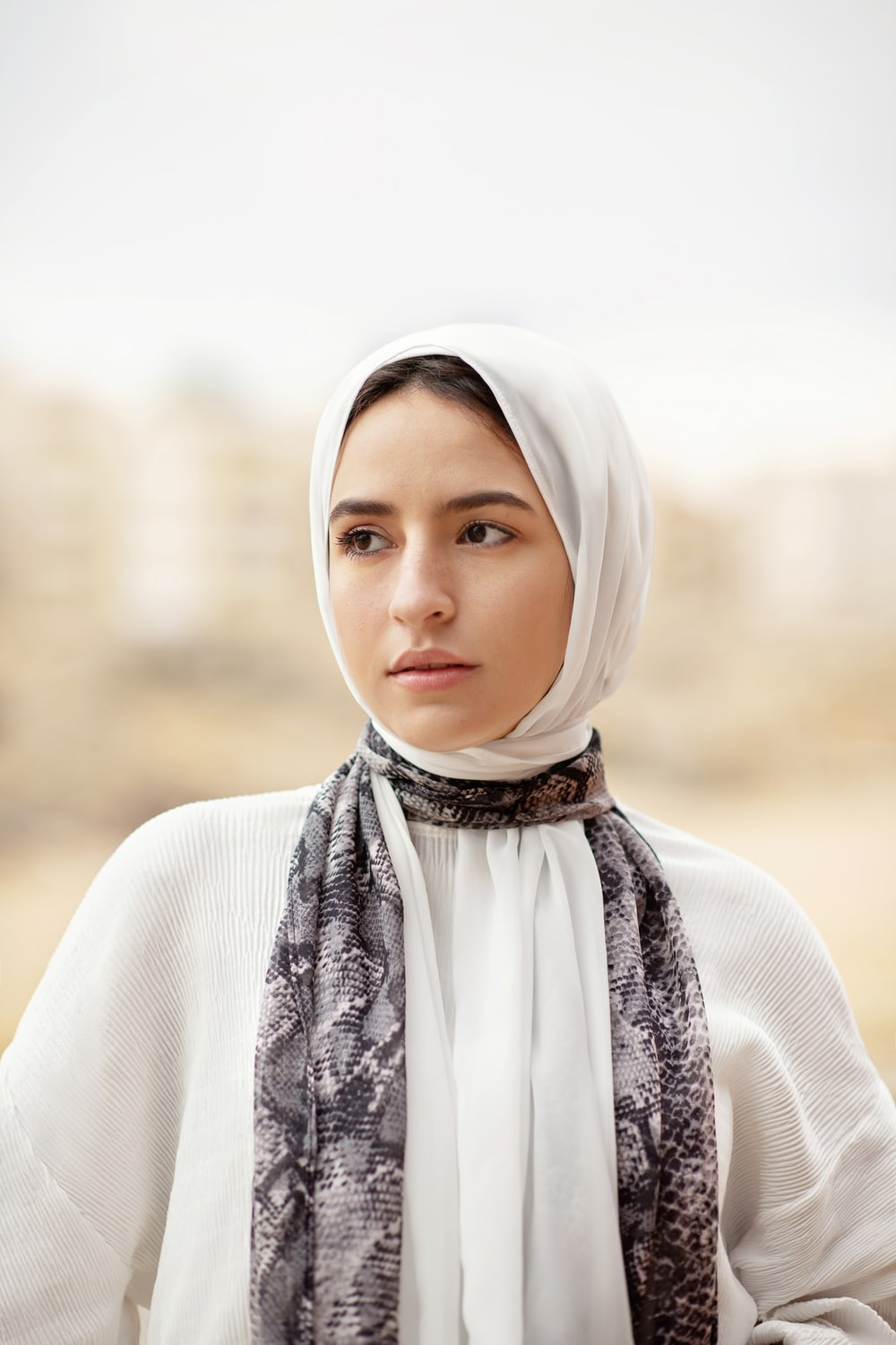 woman in white hijab and white long sleeve shirt