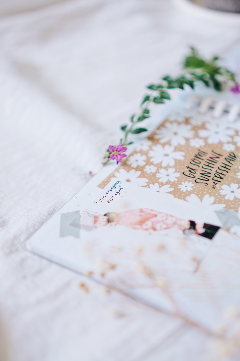 white and brown card on white textile