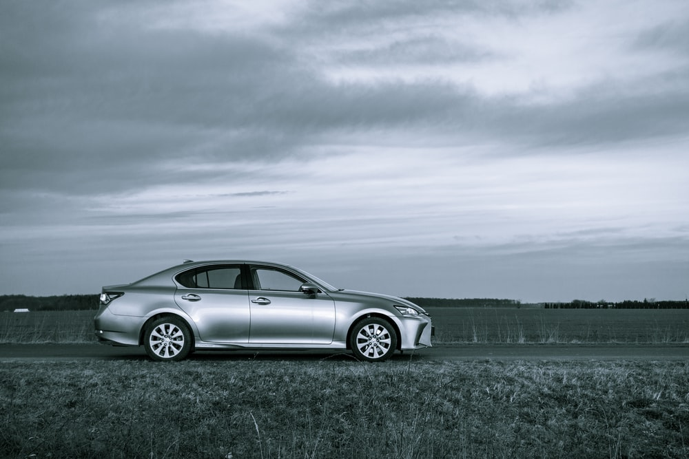silver mercedes benz coupe on road under cloudy sky