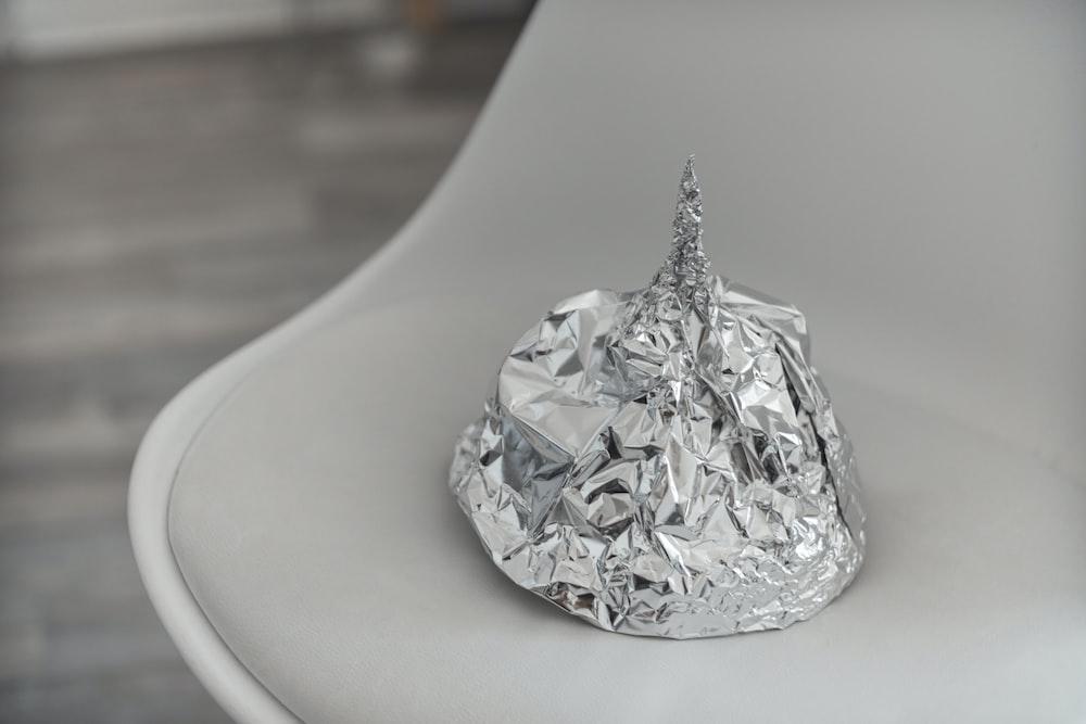 silver foil on white ceramic plate