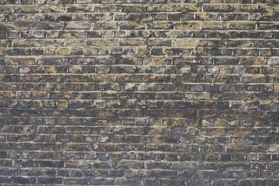 brown and black brick wall blarney stone teams background