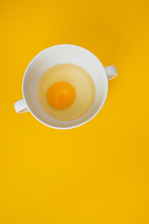 white ceramic mug with yellow liquid