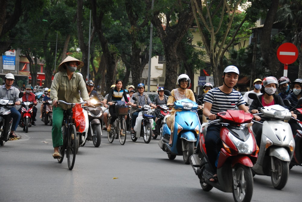 people riding on motorcycle during daytime