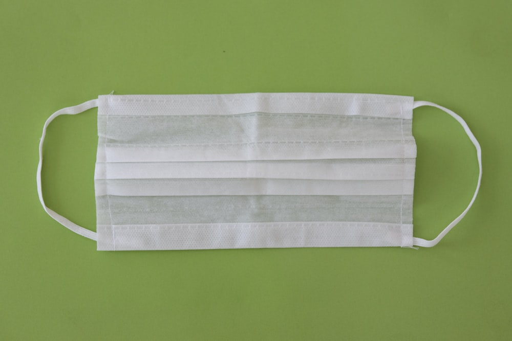 white towel on green surface