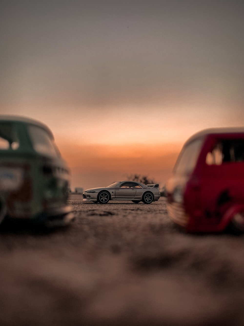 red and black volkswagen beetle on road during sunset