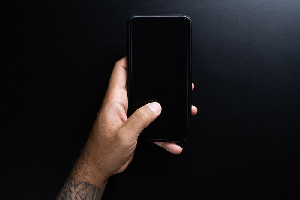 person holding black iphone 7