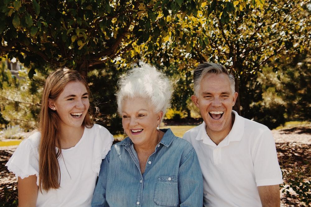 man in blue dress shirt beside woman in white shirt