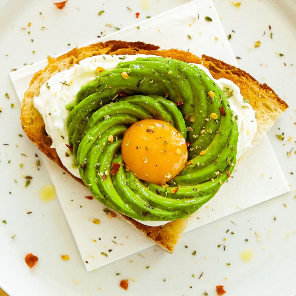 green vegetable on brown bread