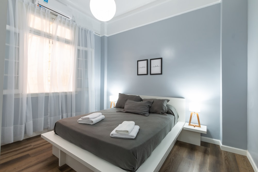 gray bed linen on bed