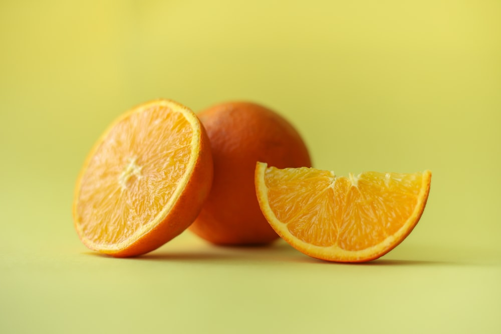 sliced orange fruit on white table