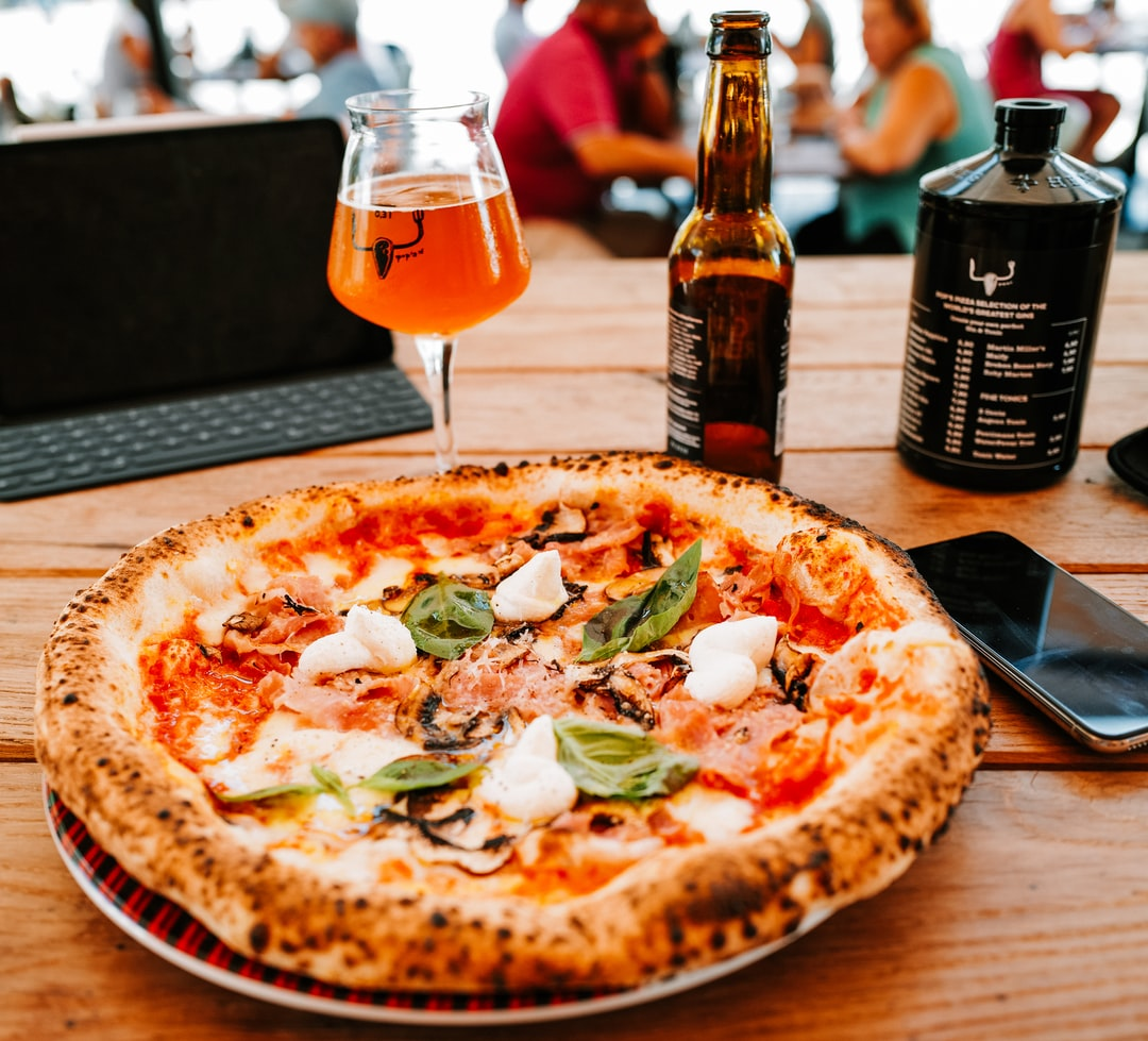 Modern Neapolitan pizza with beer.