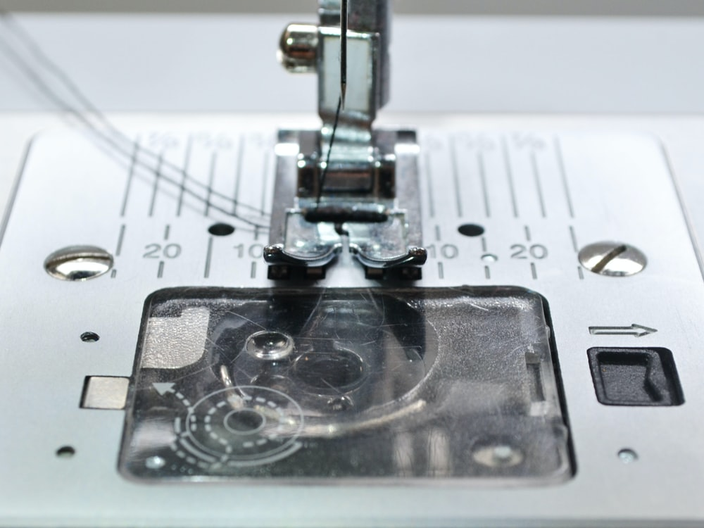 white and black sewing machine