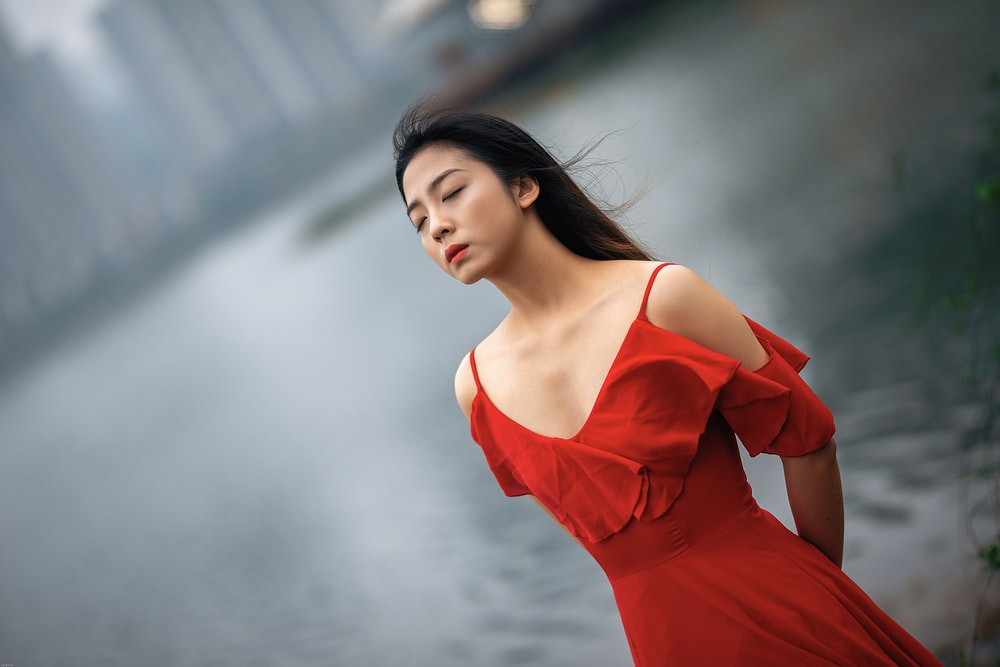 woman in red v neck dress