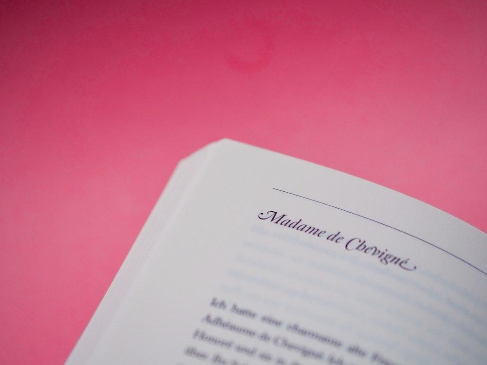 white printer paper on pink surface