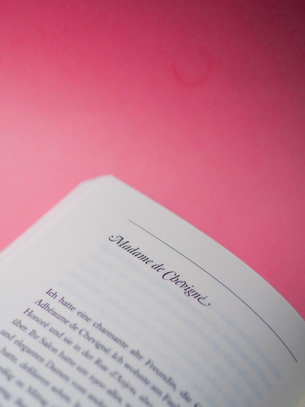 white printer paper on pink textile