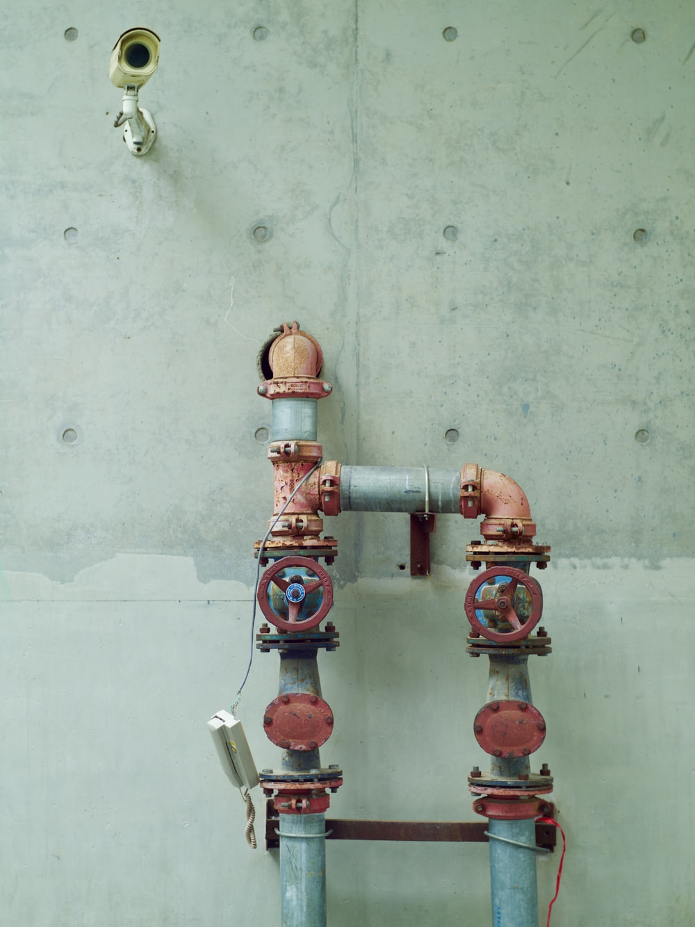 red and brown metal pipe