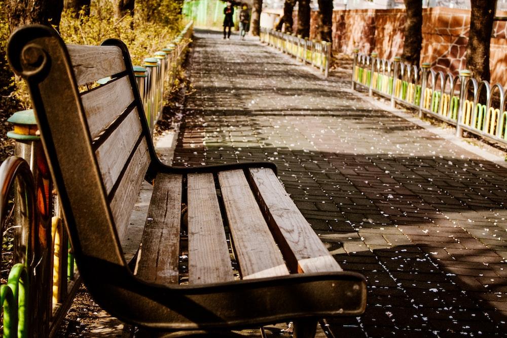 brown wooden bench on brown brick floor