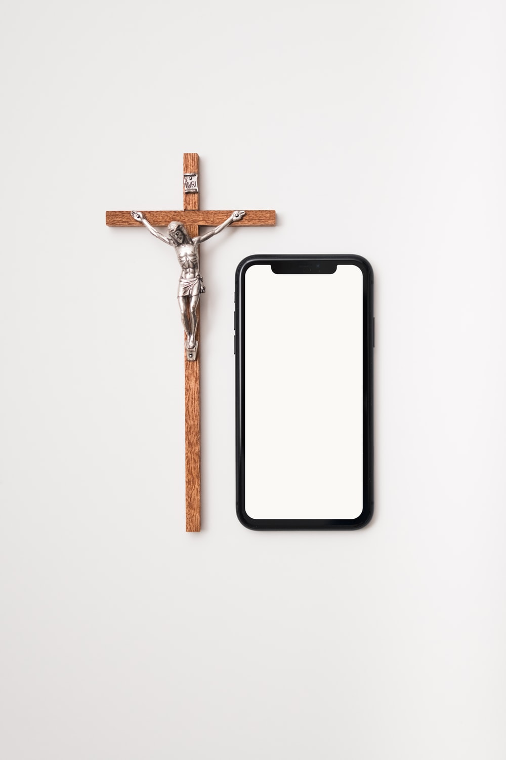 brown wooden cross with white background