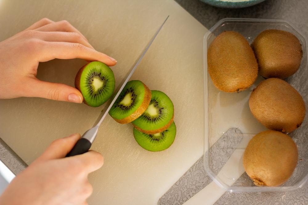 green apple fruit on white table
