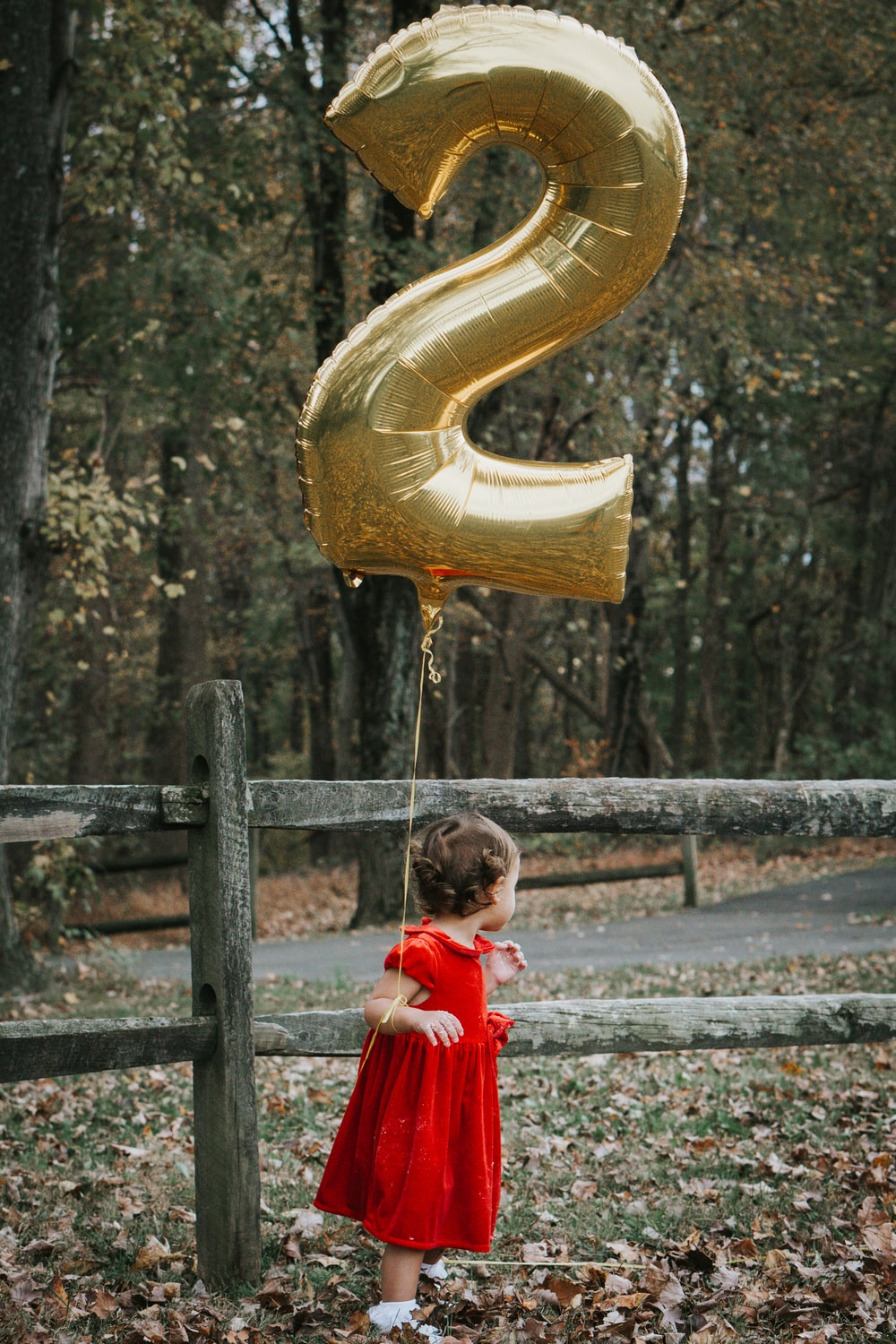 girl in red dress holding yellow inflatable ring
