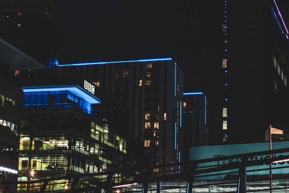 black and brown building during night time