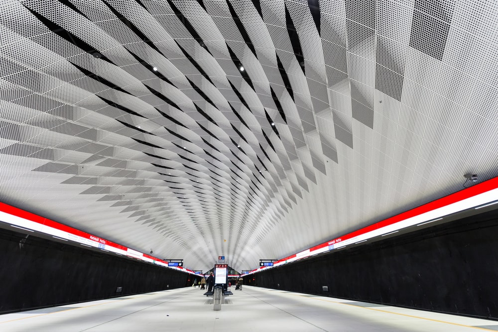 white and red road in tunnel