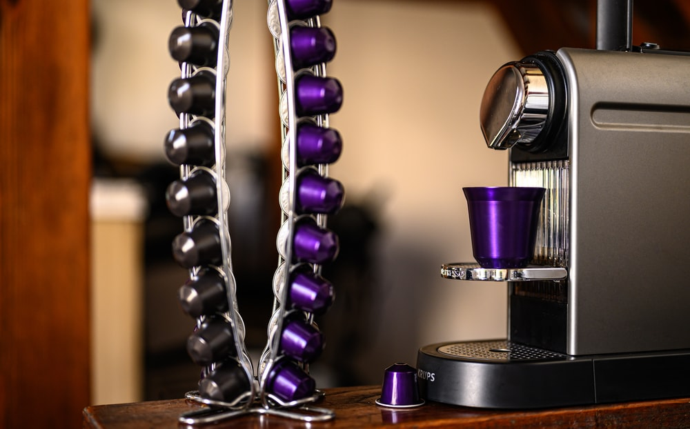 purple and silver trophy on brown wooden table