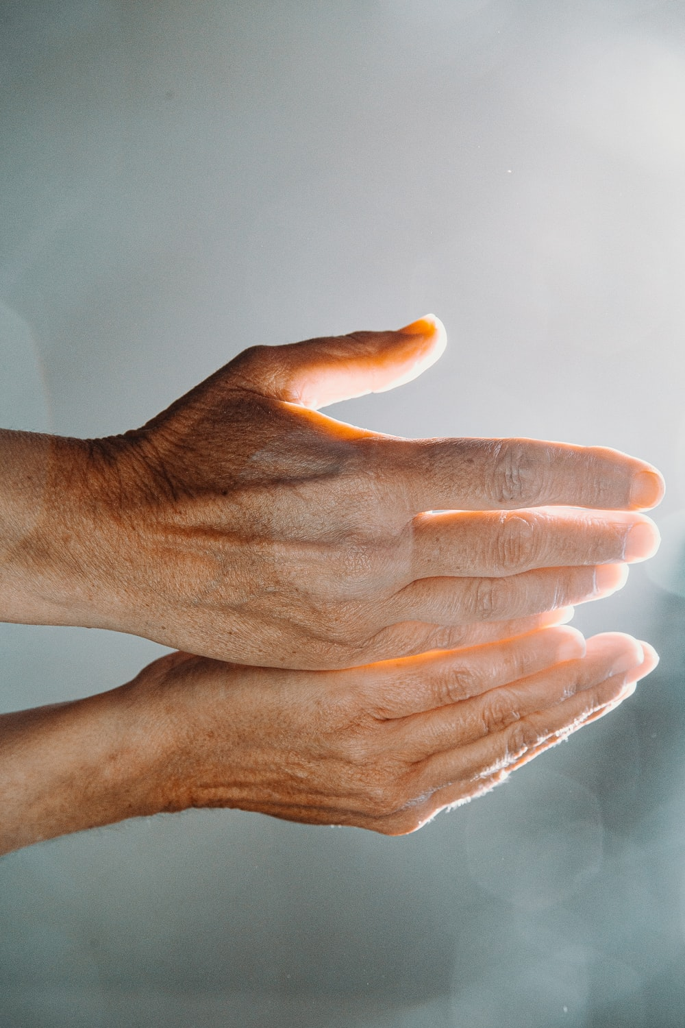 persons hand with white nail polish