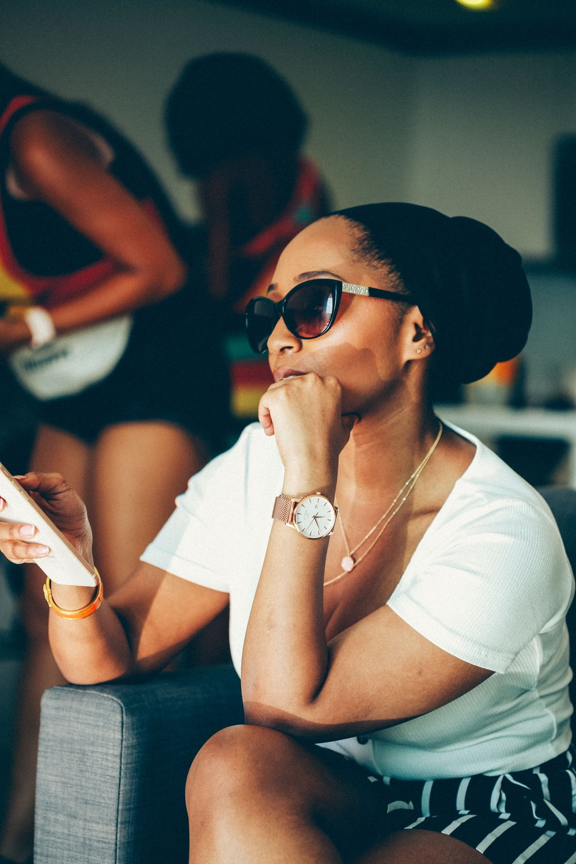 woman in white tank top wearing sunglasses