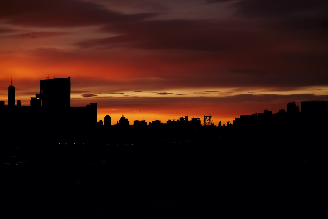 Silhouette of City Buildings During Sunset - unsplash
