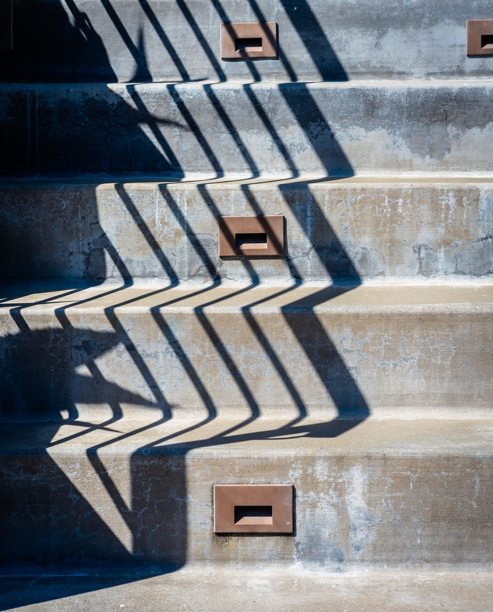 brown wooden box on gray concrete staircase