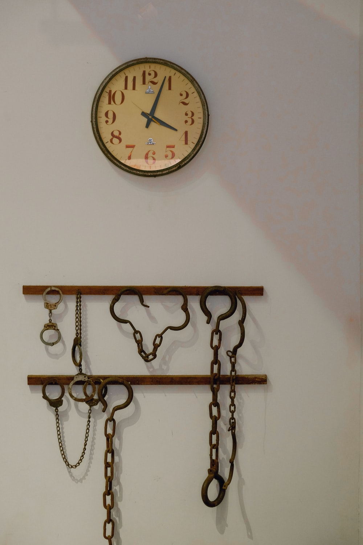 brown wooden framed analog wall clock at 10 00