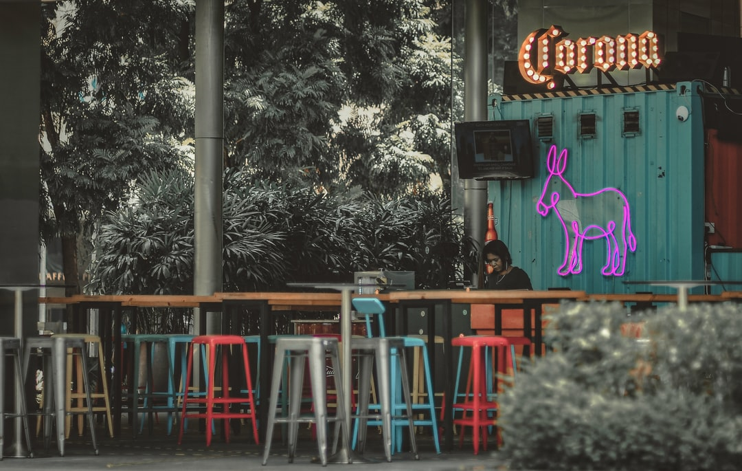 "Empty bar called ""Corona"" still opens in Singapore downtown. (Featured on SilentCities Project called ""New Emptiness"": https://www.silentcities.space)"