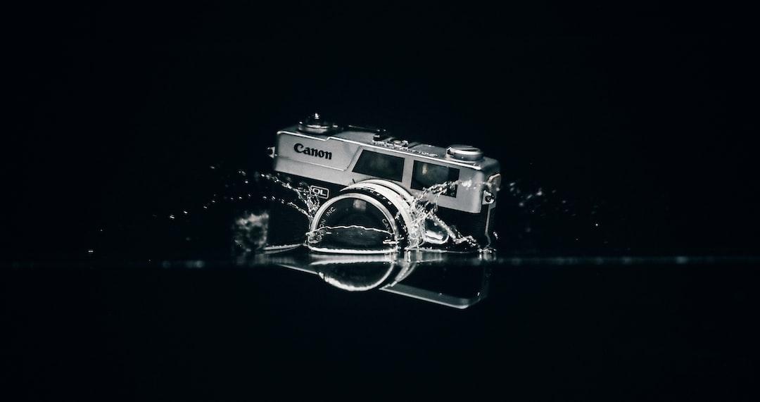 Black and Silver Camera On Black Surface - unsplash