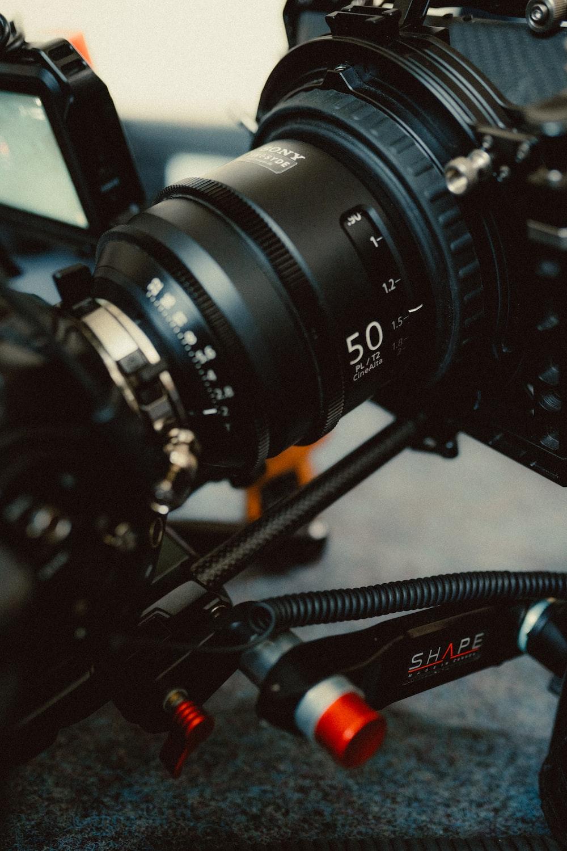 black nikon camera lens on table