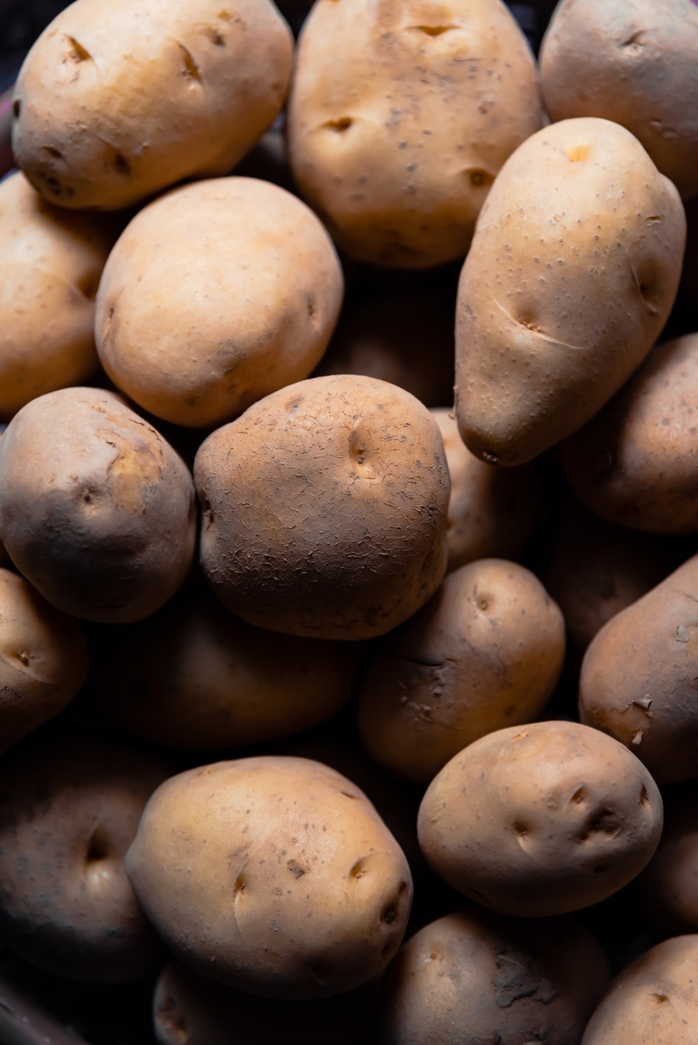 brown potatoes in close up photography