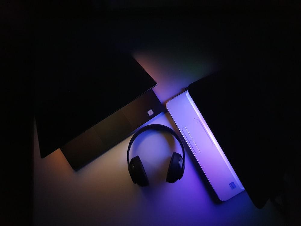 black and purple headphones on purple box