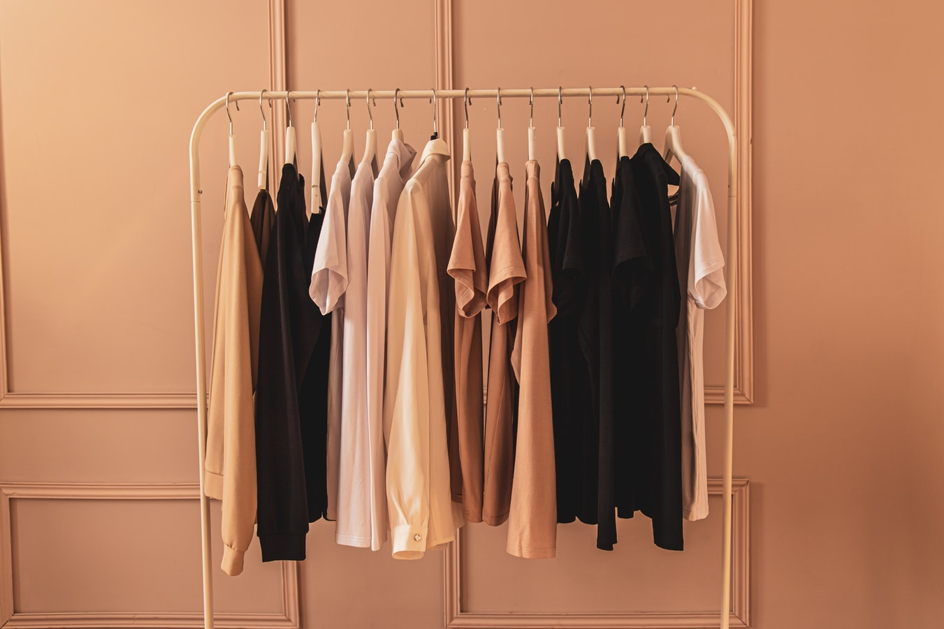 Button up shirts hanging on a rack Photo by piotr szulawski on Unsplash