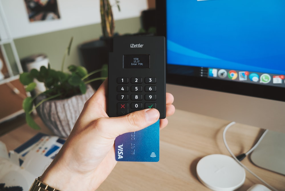 black sony remote control on persons hand