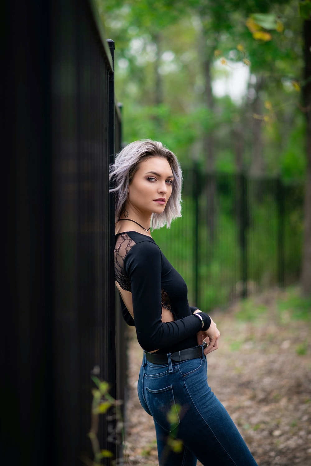 woman in black long sleeve shirt and blue denim jeans