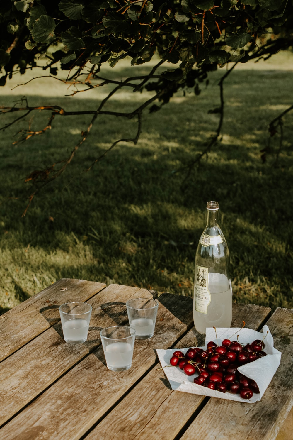 clear glass bottle on brown wooden table