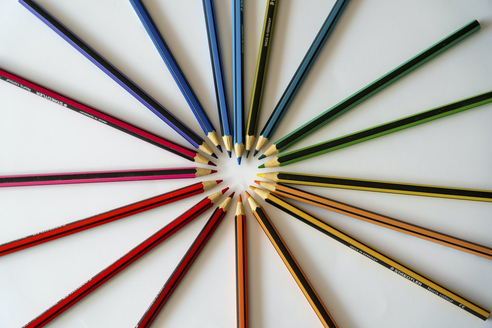 blue red green and yellow colored pencils