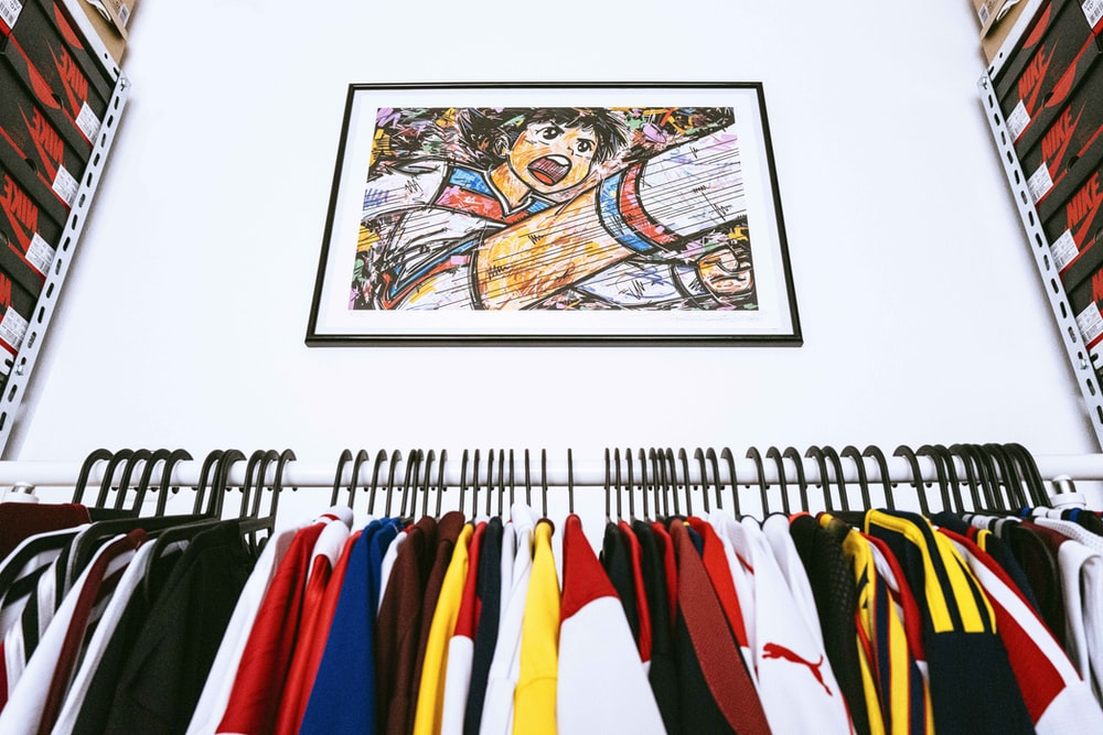 assorted color clothes hanged on clothes hanger