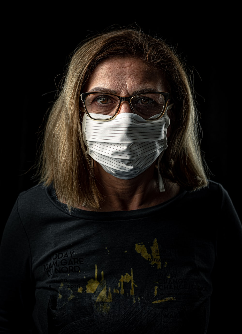 woman in black crew neck shirt with white face mask
